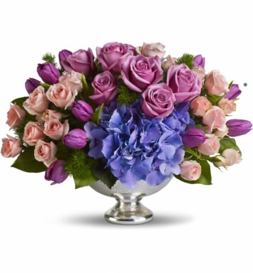 blue hydrangea with happy purple tulips and luxurious lavender and pink roses centerpiece