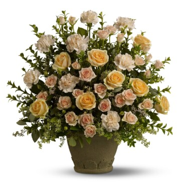 This stately arrangement features flowers such as peach roses and carnations accented with seeded eucalyptus
