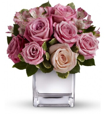 lavender and pink roses in a vase