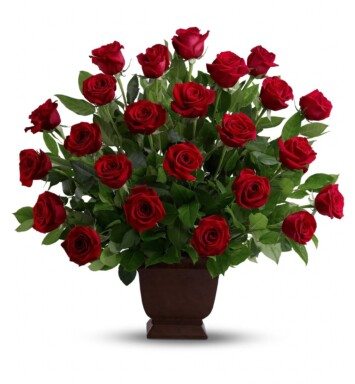 Two dozen traditional, ruby-red roses arranged in a classic urn