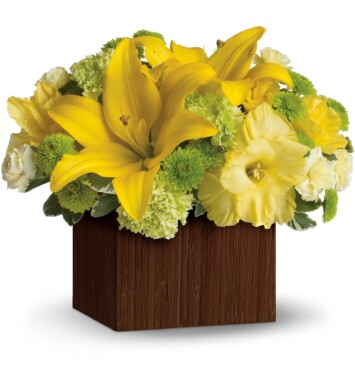 yellow asiatic lilies, roses, miniature carnations and gladioli