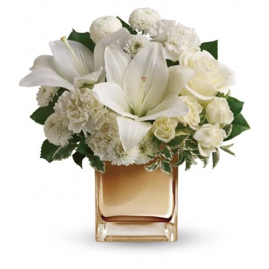 white lilies in bronze vase
