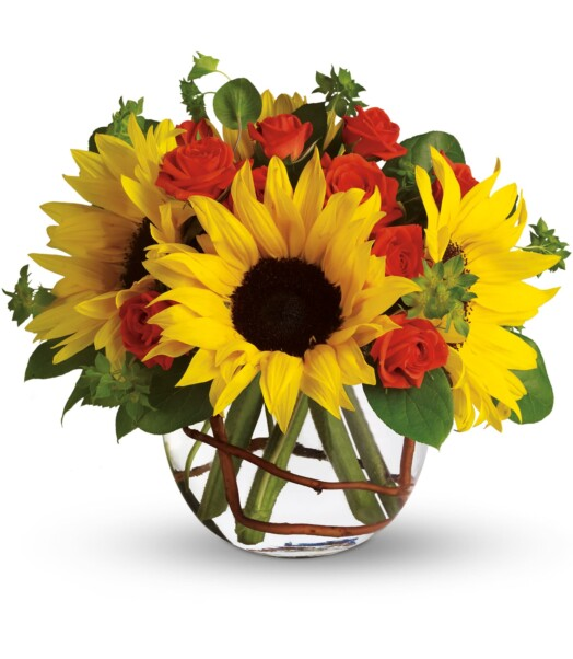 sunflowers and roses in a small glass vase