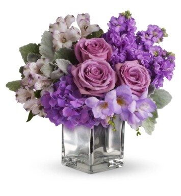 roses and hydrangea in a cube