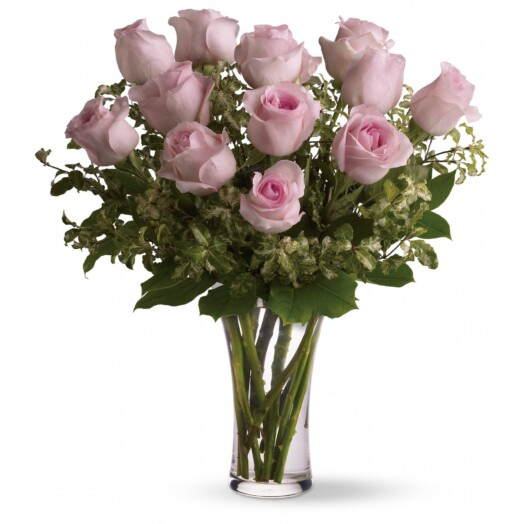 one dozen pink roses in a vase