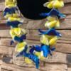 blue bombay orchid and yellow plumeria hawaiian lei