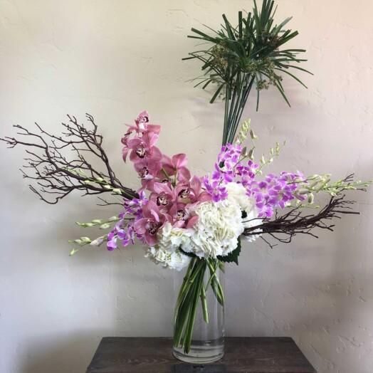 Mauve cymbidium orchids, Bombay orchids, white hydrangeas