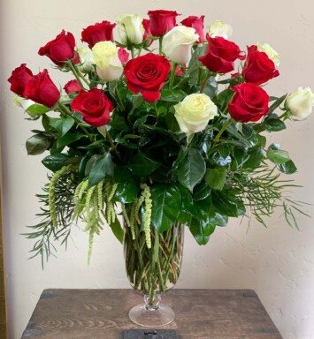 Red and White roses in a glass vase